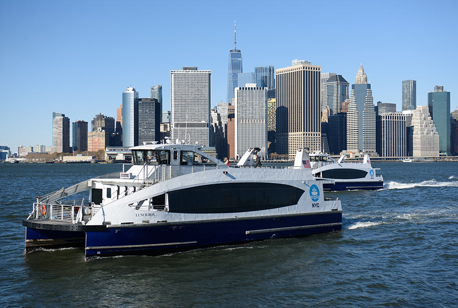 NYC ferry boat with NY skyline in background